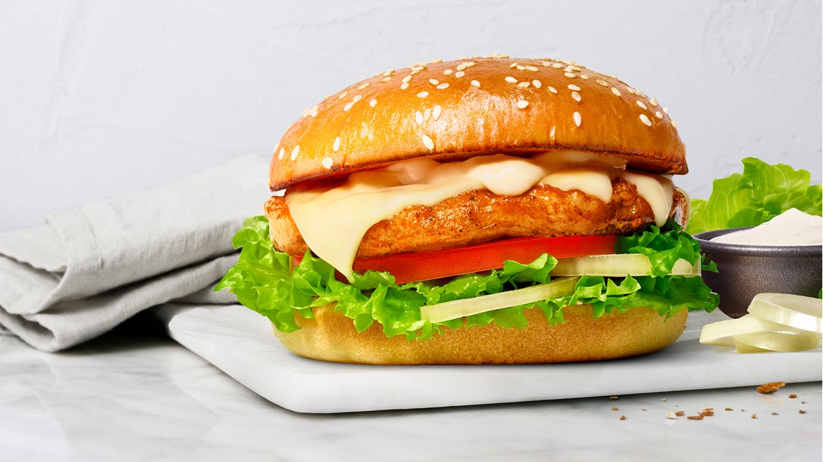 Taste Quality Responsibility stamp on image of a healthy burger. Photo.