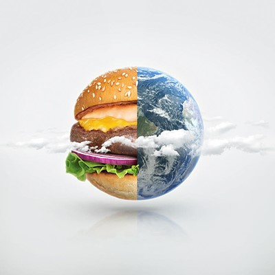 The earth half as a hamburger and half as seen from space with clouds. Photo collage
